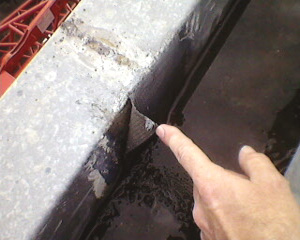 patching over an old waterproofing system